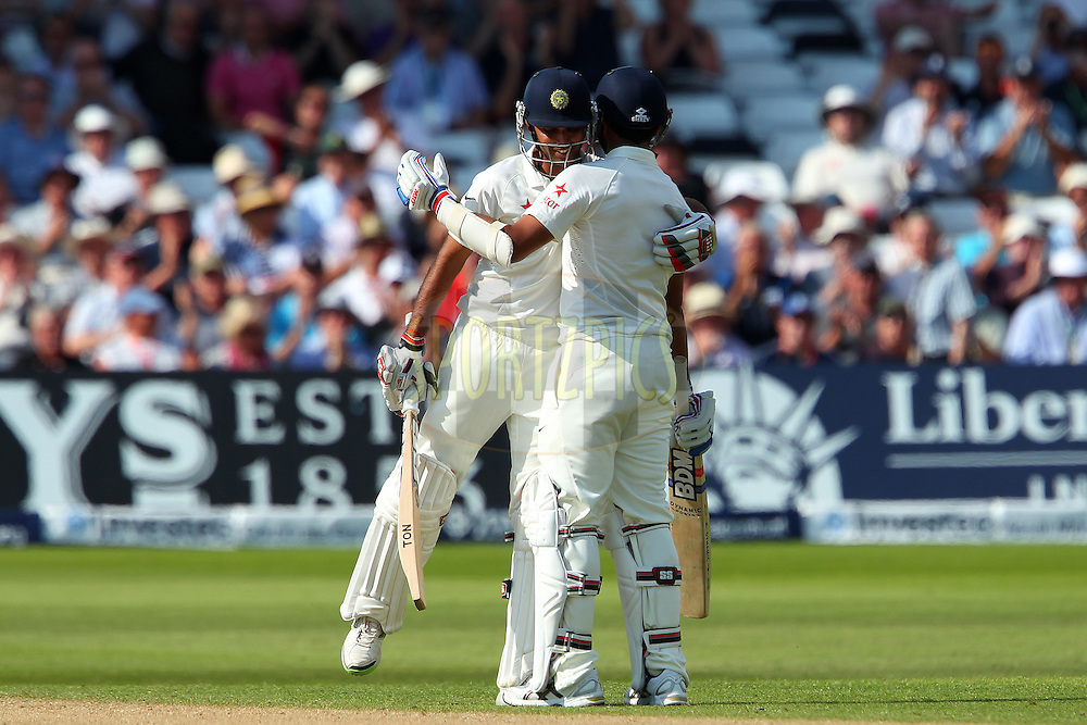Mohammed Shami celebrates his fifty with Bhuvaneshwar Kumar of India during day two of the first Investec test match between England and India held at Trent Bridge cricket ground in Nottingham, England on the 10th July 2014<br /> <br /> Photo by Ron Gaunt / SPORTZPICS/ BCCI