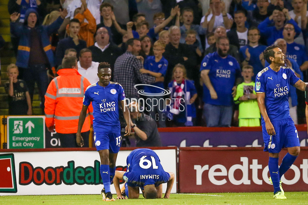 Leicester City forward Islam Slimani (19) scores a goal and celebrates by kissing the ground to make the score 0-3 during the EFL Cup match between Sheffield Utd and Leicester City at Bramall Lane, Sheffield, England on 22 August 2017. Photo by Simon Davies.