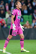 Newcastle Jets goalkeeper Glen Moss (20) shouts at team mates at the FFA Cup Round 16 soccer match between Melbourne City FC v Newcastle Jets at AAMI Park in Melbourne.