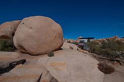 Camper Camping Under Boulders, Hidden Valley Campground, Joshua Tree National Park, California