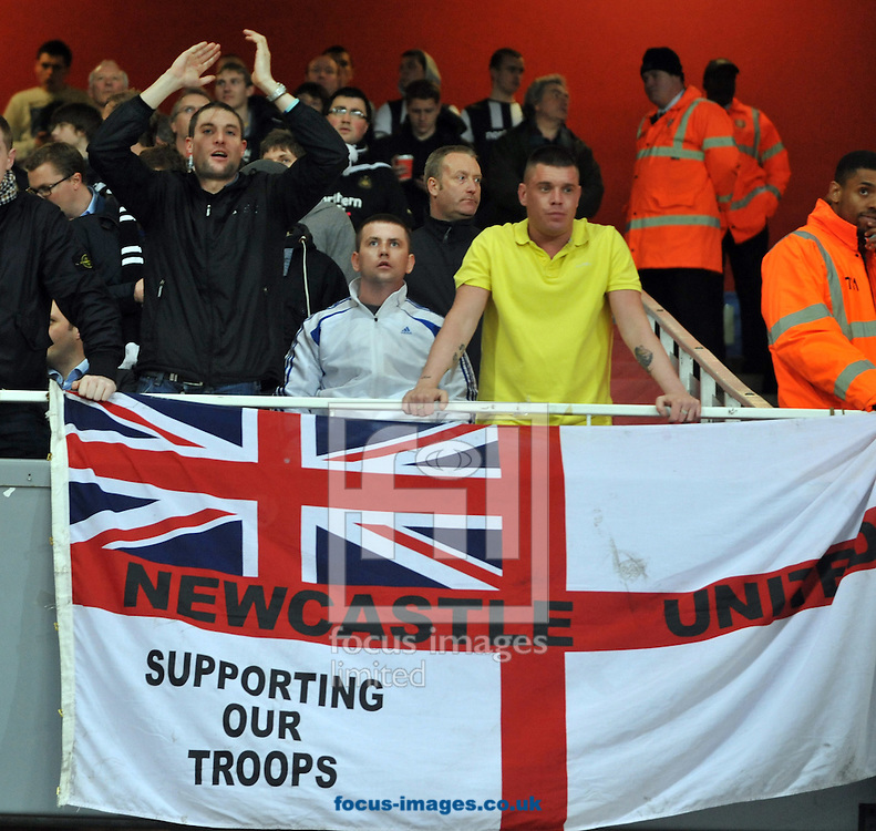 Picture by Daniel Hambury/Focus Images Ltd. 07813 022858.12/03/12.Newcastle United fans with a flag supporting British troops during the Barclays Premier League match at Emirates Stadium, London..