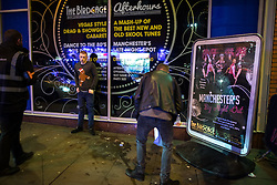 """© Licensed to London News Pictures . 24/12/2016 . Manchester , UK . Outside the Birdcage on Withy Grove . Revellers out in Manchester City Centre overnight during 2016's second """" Mad Friday """" , named for historically being one of the busiest nights of the year for the emergency services in the UK . Photo credit : Joel Goodman/LNP"""