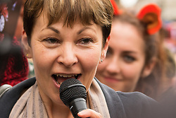 "Westminster, London, July 14th 2015. Hundreds of animal rights activists and members of hunt saboteur groups gather outside Parliament to ""Fight For THe Fox"" as Paliament discusses an amendment to the bill outlawing fox hunting that could see the sport return to the British countryside. PICTURED: The Green Party's Caroline Lucas addreses the crowd."