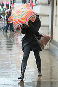 © Licensed to London News Pictures. 28/01/2015. London, UK People in wet weather in central London today 28th January 2015. Photo credit : Stephen Simpson/LNP
