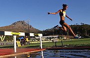 STELLENBOSCH, SOUTH AFRICA, Tuesday 20 March 2012, Nolene Conrad hurdles the water jump in the women's 3000m steeple chase during the Yellow Pages Series athletics meeting at the University of Stellenbosch Coetzenburg stadium..Photo by Roger Sedres/Image SA