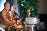 24 OCTOBER 2010 - CHANDLER, AZ: Ajahn RAYWAT leads prayers during the Ok Phansa services to mark the end of Buddhist Lent at Wat Pa, in Chandler, AZ, Sunday October 24. Buddhist Lent is a time devoted to study and meditation. Buddhist monks remain within the temple grounds and do not venture out for a period of three months starting from the first day of the waning moon of the eighth lunar month (in July) to the fifteenth day of the waxing moon of the eleventh lunar month (in October). Ok Phansa Day marks the end of the Buddhist lent and falls on the full moon of the eleventh lunar month, this year Oct 23. Wat Pa, a Thai Theravada Buddhist temple, celebrated Ok Phansa Day on October 24.    Photo by Jack Kurtz