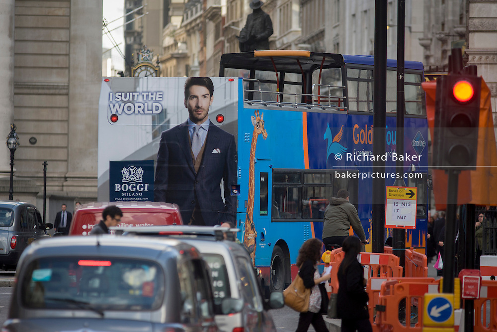 Fashion ad for Italian menswear retailer Boggi on the back of a tourist bus in the City of London.