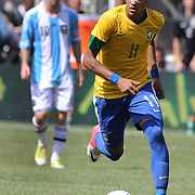 Neymar, Brazil, in action watched by Lionel Messi, Argentina, (left)  during the Brazil V Argentina International Football Friendly match at MetLife Stadium, East Rutherford, New Jersey, USA. 9th June 2012. Photo Tim Clayton