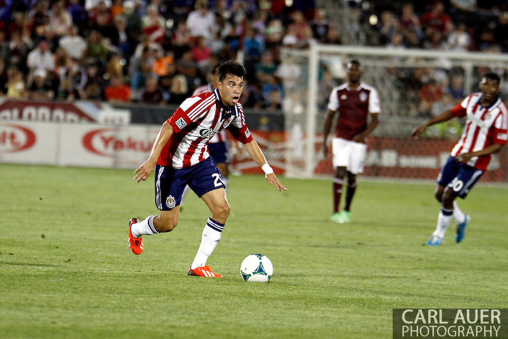 May 25th, 2013 Commerce City, CO - Chivas USA midfielder Carlos Alvarez (20) brings the ball up the field in the second half of the MLS match between Chivas USA and the Colorado Rapids at Dick's Sporting Goods Park in Commerce City, CO