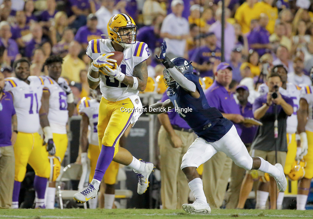 Aug 31, 2019; Baton Rouge, LA, USA; LSU Tigers tight end Thaddeus Moss (81) catches a pass over Georgia Southern Eagles cornerback Monquavion Brinson (4) during the first quarter at Tiger Stadium. Mandatory Credit: Derick E. Hingle-USA TODAY Sports
