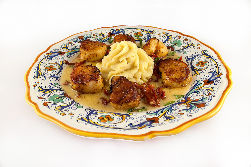 Grilled Scallops with Sun-Dried Tomatos, Basil and Beurre Blanc with Garlic Whipped Potatoes.