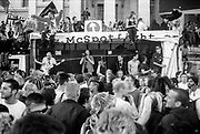 Crowd dancing in front of sound system, Reclaim the Streets, Trafalgar Square, London, May 1997