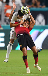 Jesus Vallejo of Real Madrid pulls down Alexis Sanchez of Manchester United while trying to head the ball away in the first half during International Champions Cup action at Hard Rock Stadium in Miami Gardens, FL, USA on Tuesday, July 31, 2018. Manchester United won, 2-1. Photo by Jim Rassol/Sun Sentinel/TNS/ABACAPRESS.COM