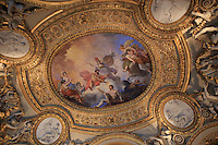 Intricately painted ceilings line the roof of The Louvre Museum in Paris, France.