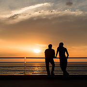 Men chat as they watch the sunset along the oceanside Boulevard de la Corniche in Casablanca, Morocco on 9 September 2013.
