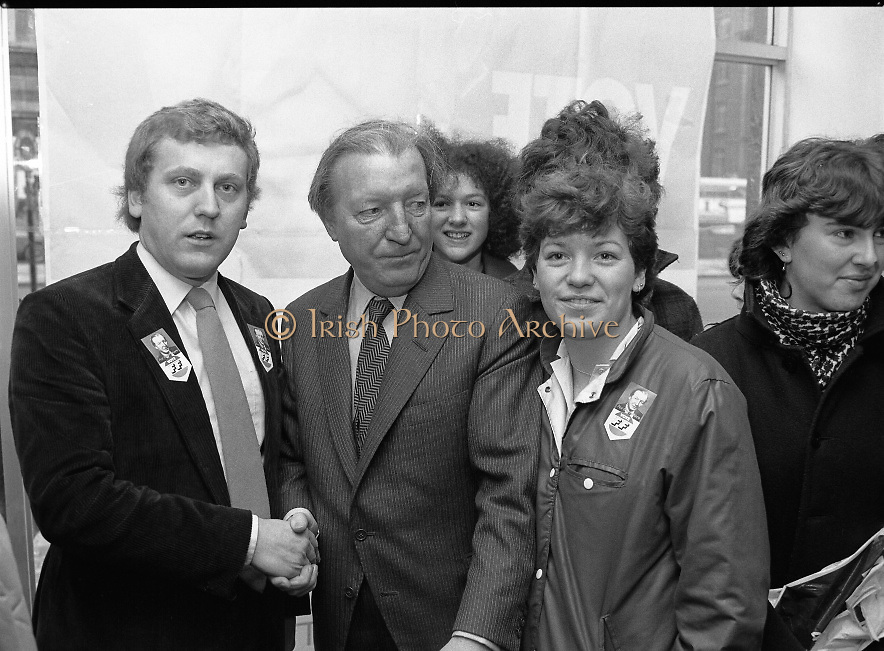 """Opening of New Ogra Fianna Fail office on O'Connell St,Dublin.1982.30.01.1982.01.30.1982.30th January 1982..Picture of Mr Haughey,.Leader of Fianna Fail, A.as he is welcomed by Mr Cillian Brioscu,.Chairman,Cumann Sean Mhisteil,Dublin. Also in the picture are members of """"Ogra"""".."""