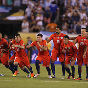 EAST RUTHERFORD, NEW JERSEY - JUNE 26: The Chile players on the half way line during the final penalty kick which gave their side victory after winning the penalty shoot out during the Argentina Vs Chile Final match of the Copa America Centenario USA 2016 Tournament at MetLife Stadium on June 26, 2016 in East Rutherford, New Jersey. (Photo by Tim Clayton/Corbis via Getty Images)