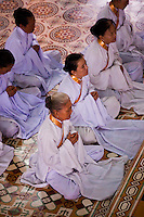 Worshippers during a Cao Dai service at Tay Ninh's Holy See.