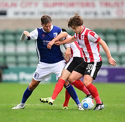 Barrow's Richard Bennett vies for possession with Lincoln City's Sam Habergham, centre, and Lincoln City's Alex Woodyard<br /> <br /> Picture: Chris Vaughan/Chris Vaughan Photography<br /> <br /> Football - Vanarama National League - Lincoln City Vs Barrow - Saturday 17th September 2016 - Sincil Bank - Lincoln<br /> <br /> Copyright © 2016 Chris Vaughan Photography. All rights reserved. Unit 11, Churchill Business Park, Bracebridge Heath, Lincoln, LN4 2FF - Telephone: 07764170783 - info@chrisvaughanphotography.co.uk - www.chrisvaughanphotography.co.uk