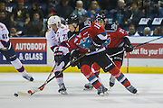 KELOWNA, CANADA - NOVEMBER 26:  Jordan Borstmayer #11 of the Kelowna Rockets fights for the puck against Adam Brooks #77 of the Regina Pats at the Kelowna Rockets game on November 26, 2016 at Prospera Place in Kelowna, British Columbia, Canada.  (Photo By Cindy Rogers/Nyasa Photography,  *** Local Caption ***