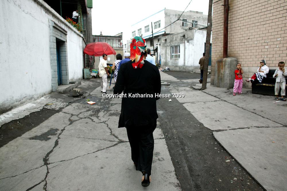 """URUMQI, JULY-15 : """" They threw a shirt over his head and led him away without saying a word,"""" said his wife, Resuangul while walking in an alley in Urumqi's Xiangyang Po district, a poor quarter of the city dominated by Uighurs, Turkic-speaking Muslims who have often had an uneasy relationship with China's Han majority. Uighurs are the largest ethnic group in Xinjiang, but in Urumqi, Han make up more than 70 percent of the 2.3 million residents.<br /> Many Han Chinese were killed in Xiangyang Po during the protests in early July 2009."""