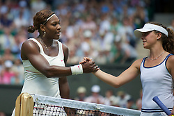 LONDON, ENGLAND - Tuesday, June 22, 2010: Serena Williams (USA) and Michelle Larcher De Brito (POR) after the Ladies' Singles 1st Round match on day two of the Wimbledon Lawn Tennis Championships at the All England Lawn Tennis and Croquet Club. (Pic by David Rawcliffe/Propaganda)