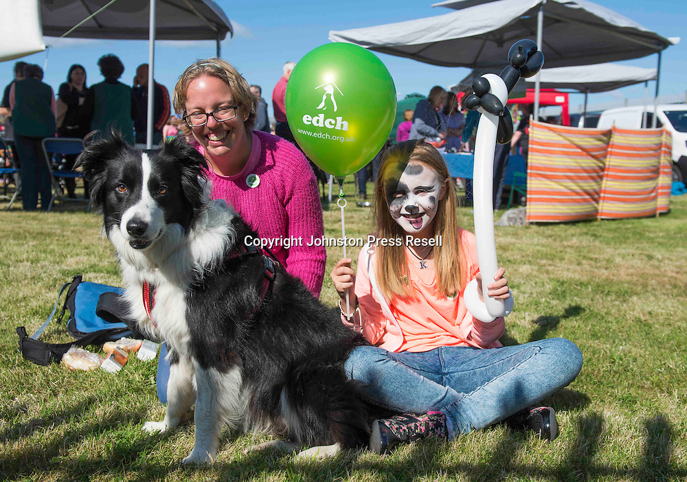 Kayla Sneddon (10) with Mum Kerry Sneddon and Border Collie Jack<br /> <br /> Edinburgh Cat and Dog Home open day. <br /> 6th September 2015<br /> <br /> picture by Alex Hewitt<br /> alex.hewitt@gmail.com<br /> 07789 871 540
