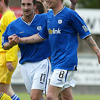 Montrose v St Johnstone....10.07.04<br />Trialist Mark Robinson congratulates Ryan Stevenson on his second goal<br /><br />Picture by Graeme Hart.<br />Copyright Perthshire Picture Agency<br />Tel: 01738 623350  Mobile: 07990 594431