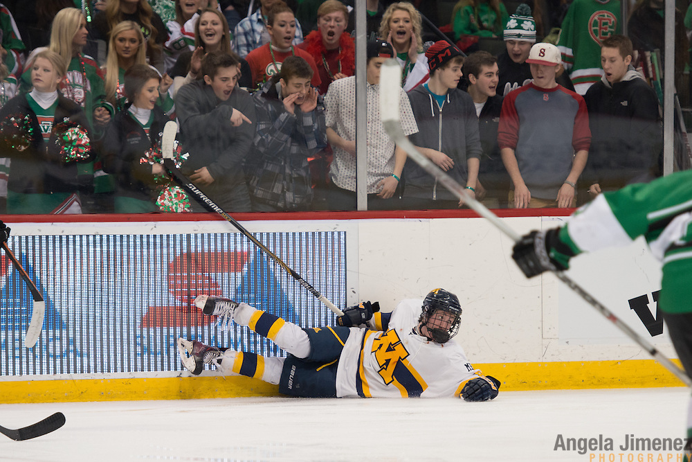 East Grand Forks fans taunt Mahtomedi player Mike Kneale during the Class A semifinal game between Mahtomedi and East Grand Forks (East Grand Forks won 5-2) at the Minnesota State High School League Boys' State Hockey Tournament at the Xcel Energy Center in St. Paul, Minnesota on March 6, 2015. <br />  <br /> <br /> Photo by Angela Jimenez for Minnesota Public Radio www.angelajimenezphotography.com