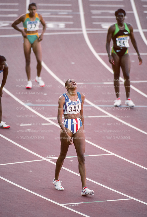 GOTHENBURG, SWEDEN -  AUGUST 8:   Marie-Jose Perec #347 of France wins the Women's 400 meter race of the 1995 IAAF World Championships  on August 8, 1995 at Ullevi Stadium in Gothenburg, Sweden.   Visible in background is Cathy Freeman (at top left) of Australia.  (Photo by David Madison/Getty Images)