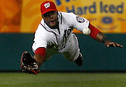 Washington Nationals Washington Nationals right fielder Roger Bernadina dives for a ball hit by New York Mets New York Mets first baseman Ike Davis during the ninth inning of their MLB National League baseball game in Washington, April 27, 2011.  REUTERS/Jim Young