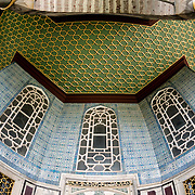 The Baghdad Pavilion (or Baghdad Kiosk) was built to commemorate the Baghdad Campaign of Sultan Murad IV after 1638. With its tiles dating to the 17th century, mother-of-pearl, tortoise-shell decorated cupboard and window panels, this pavilion is one of the last examples of the classical palace architecture. From the mid-18th century onwards, the building was used as the Library of the Privy Chamber. On a peninsula overlooking both the Bosphorus Strait and the Golden Horn, Topkapi Palace was the primary residence of the Ottoman sultans for approximately 400 years (1465–1856) of their 624-year reign over Constantinople and the Ottoman Empire. Today it is one of Istanbul's primary tourist attractions.