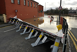 © Licensed to London News Pictures. 02/04/2014; Bristol, UK.  A portable flood barrier is set up in Avon Crescent near Bristol docks, to protect a row of houses from spring tide flooding from the river Avon.  Cumberland Road was also closed to most vehicles though some drove through.<br /> Photo credit: Simon Chapman/LNP
