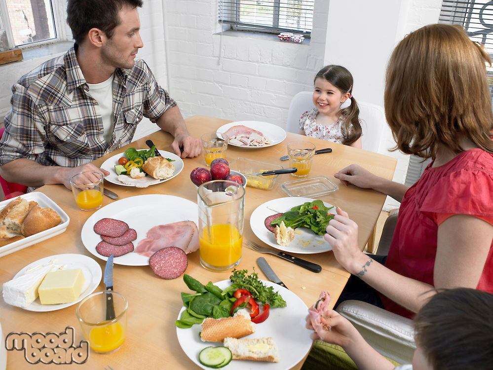 Family with children (3-6) at dining room table