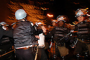 CHICAGO, IL - March 21, 2003: A protester is arrested after antiwar demonstrators shut down Chicago's Lake Shore Drive to protest the start of the Iraq war. <br /> <br /> Police arrested more then 900 people during the protest. In 2012, the city agreed to pay protesters 12 million dollars to settle a wrongful arrest lawsuit against the city for the police's actions.