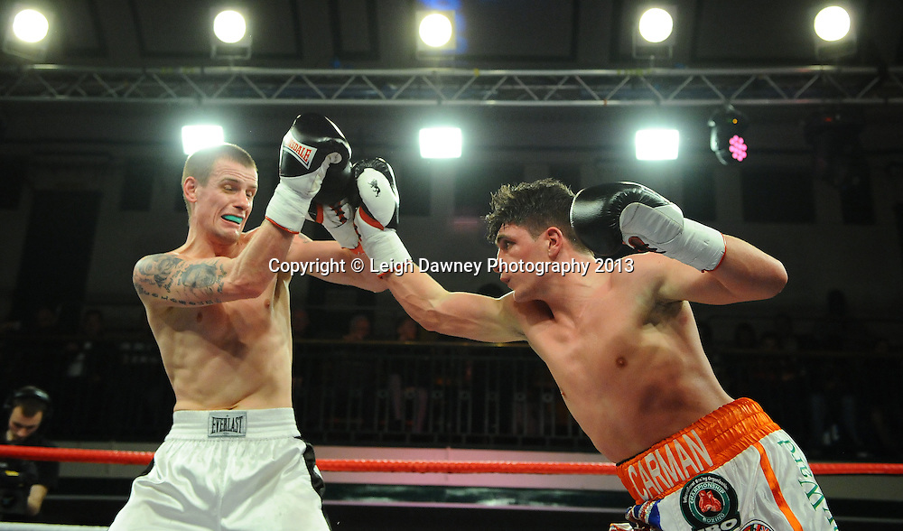 Sylvester Waljzak (white/black shorts) defeats George Carmen at York Hall, Bethnal Green, London, UK on the 15th March 2013. Frank Maloney Promotions. © Leigh Dawney Photography 2013.