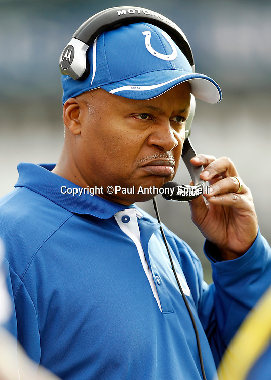 Indianapolis Colts head coach Jim Caldwell grimaces during the NFL week 16 football game against the Oakland Raiders on Sunday, December 26, 2010 in Oakland, California. The Colts won the game 31-26. (©Paul Anthony Spinelli)