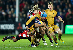 Jordan Crane (capt) of Bristol Rugby is tackled by Richard Hibbard of Gloucester Rugby - Rogan Thomson/JMP - 03/12/2016 - RUGBY UNION - Kingsholm Stadium - Gloucester, England - Gloucester Rugby v Bristol Rugby - Aviva Premiership.