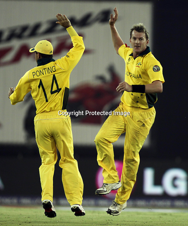 Australia captain Rickey Ponting and Brett Lee celebrates Indian batsman MS Dhoni wicket during the 2nd Quarter-Final match India v Australia Played at Sardar Patel Stadium, Motera, Ahmedabad 24 March 2011 - day/night (50-over match)