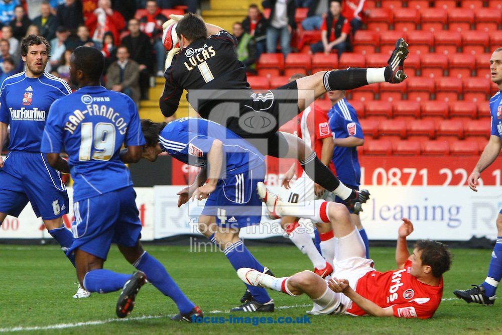 London - Monday May 17th 2010: After collecting a cross in the 1st minute David Lucas of Swindon is injured and has to go off during the Coca Cola League One Play Off Semi Final 2nd Leg match at The Valley, Charlton. (Pic by Paul Chesterton/Focus Images)