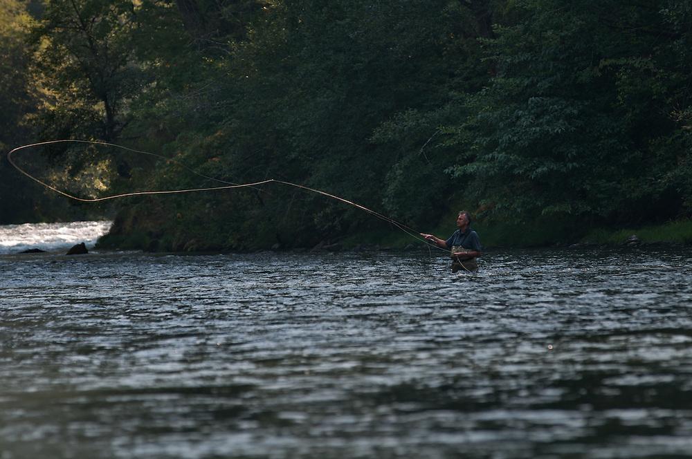 A fly fisherman cast while fishing the North Umpqua River for steelhead.