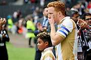 MKDons defender Dean Lewington (3) leads the team out before the EFL Sky Bet League 2 match between Milton Keynes Dons and Exeter City at stadium:mk, Milton Keynes, England on 25 August 2018.