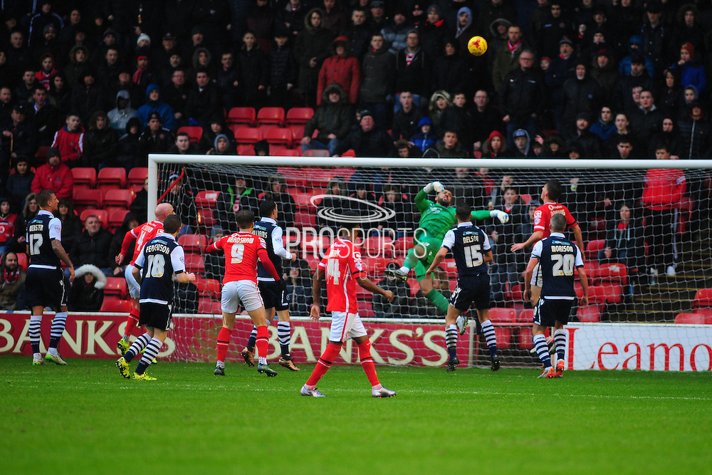 Jordan Archer of Millwall FC saves from Tom Bradshaw of Walsall FC during the Sky Bet League 1 match between Walsall and Millwall at the Banks's Stadium, Walsall, England on 6 February 2016. Photo by Mike Sheridan.