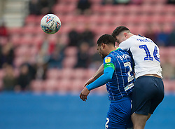 Nathan Byrne of Wigan Athletic (L) and Andrew Hughes of Preston North End in action - Mandatory by-line: Jack Phillips/JMP - 08/02/2020 - FOOTBALL - DW Stadium - Wigan, England - Wigan Athletic v Preston North End - English Football League Championship