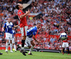 Dimitar Berbatov shows his frustration after near miss during the Barclays Premier League match between Manchester United and Birmingham City at Old Trafford on August 16, 2009 in Manchester, England.