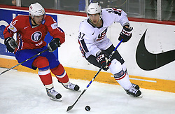 Jonas Holos of Norway and Mark Burish (37) of USA at ice-hockey game Norway vs USA at Qualifying round Group F of IIHF WC 2008 in Halifax, on May 12, 2008 in Metro Center, Halifax, Nova Scotia, Canada. USA won 11:1. (Photo by Vid Ponikvar / Sportal Images)