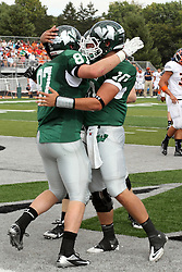 28 September 2013:  Taylor Dee and Rob Gallik celebrate in the end zone during an NCAA division 3 football game between the Hope College Flying Dutchmen and the Illinois Wesleyan Titans in Tucci Stadium on Wilder Field, Bloomington IL