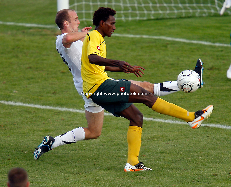 NZ's Michael Eager blocks the shot from Vanuatu's Jean Kaltack. OFC Men's Olympic Qualifier New Zealand 2012 Semi Final, New Zealand v Vanuatu, Owen Delany Park Taupo, Friday 23rd March 2012. Photo: Shane Wenzlick