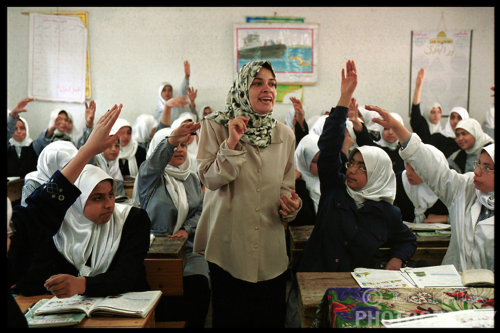 School children in the Jabalyah Refugee Camp in Gaza, are eager to answer their teachers question during an English language class. (Photo © Jock Fistick)