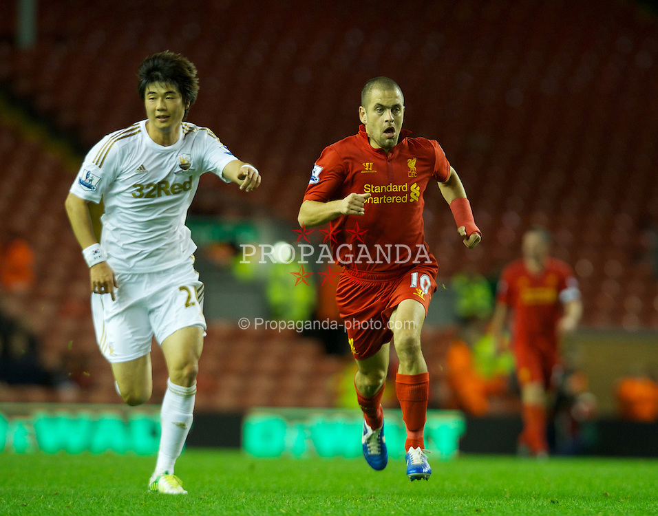 LIVERPOOL, ENGLAND - Wednesday, October 31, 2012: Liverpool's Joe Cole in action against Swansea City's Ki Sung-Yeung during the Football League Cup 4th Round match at Anfield. (Pic by David Rawcliffe/Propaganda)